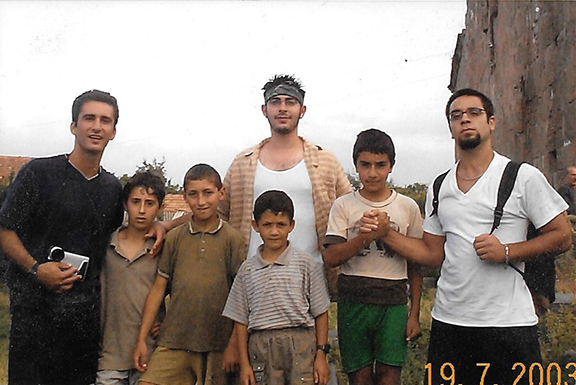 Hovig Apo Saghdejian and fellow Land and Culture Organization (LCO) volunteers with the children of Ayroum where they were working during the summer of 2003.