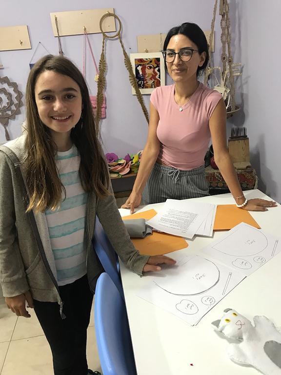 Ani teaching Hripsime Melkonyan Orran volunteer to make puppet templates