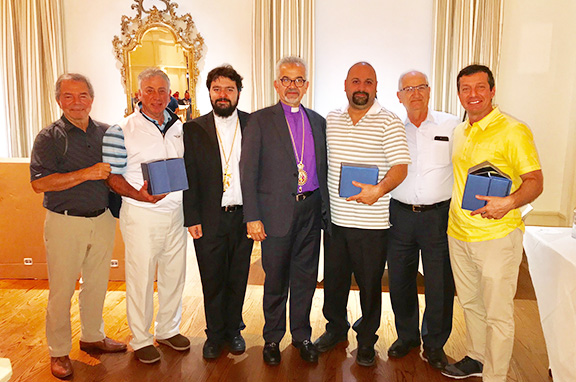 Prelate Archbishop Moushegh Mardirossian flanked by Gerald and Mark Golf Classic participants