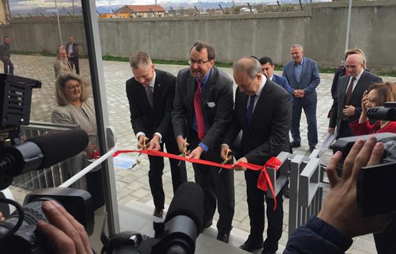 US Ambassador to Armenia Richard Mills cuts the ribbon at a lab in Martuni