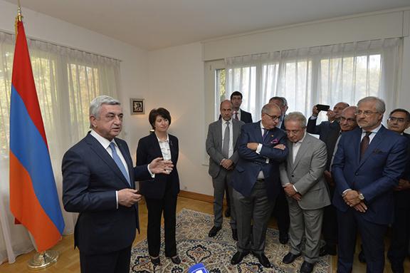 President Serzh Sarkisian briefs Armenian community members at the Armenian Embassy in Geneva on Oct. 16