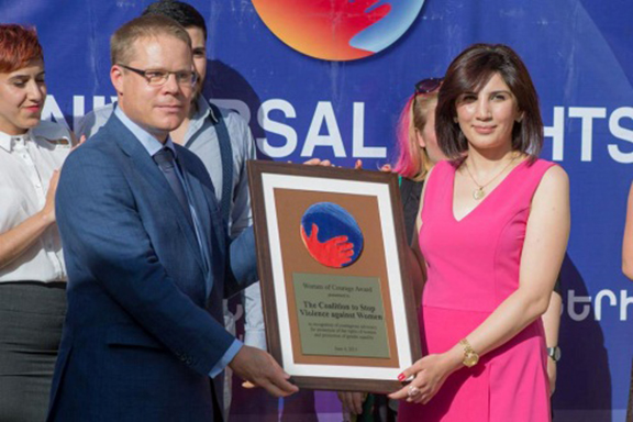 Hasmik Khachatryan receiving Woman of Courage award from international organizations and civil society in Armenia