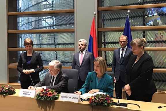 Armenia's Foreign Minister Edward Nalbandian and EU's representative of foreign affairs, Federica Mogherini. sign the comprehensive agreement with President Serzh Sarkisian and the President of the European Council Donald Tusk looking on