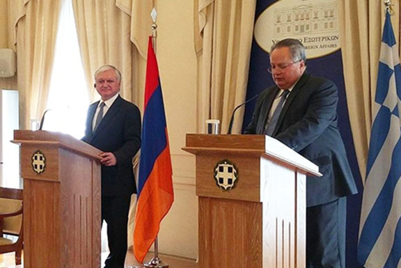 Armenia's Foreign Minister Edward Nalbandian (left) with his Greek counterpart Nikos Kotzias speaks at a press conference in Athens on Wednesday