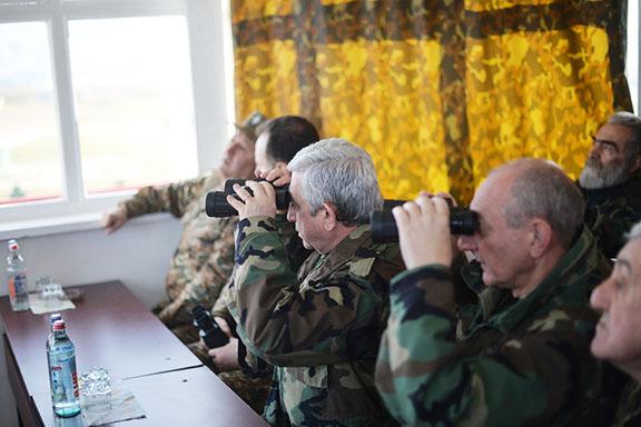 President Serzh Sarkisian (left) and Artsakh President Bako Sahakian watch military exercises in Artsakh on Sarturday