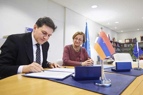 Ambassador Paruyr Hovhannisyan signs the Istanbul Convention as Deputy Secretary General of the Council of Europe,Gabriella Battaini-Dragoni looks on