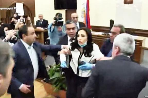 Yerkir Tsirani member Manina Khachatryan is being attacked during a city council meeting (Azatutyun.am)