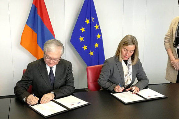 Armenia's Foreign Minister Edward Nalbandian with EU's High Representative for Foreign Affairs  Federica Mogherini sign agreement in Brussels on Wednesday