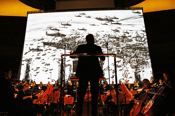 """Kevork Mourad's illustrations serve as a backdrop for """"Israel in Egypt"""" at Walt Disney Concert Hall. (Photo by Patrick Brown)."""