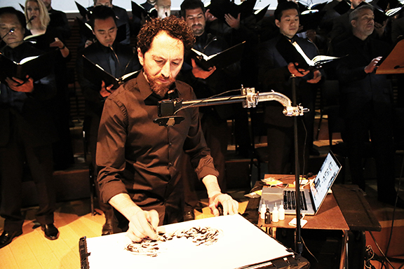 Kevork Mourad creating visual illustrations during Los Angeles Master Chorale's concert at Disney Hall. (Photo by Patrick Brown).