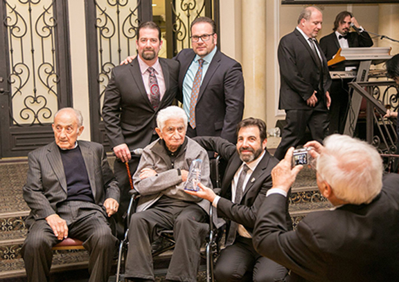 Karpo Dilanian, who during his youth filmed and documented life in the Armenian DP Camp, received the Mesrobian Legacy Award. First Row from l to r: Kirk Felikian, Montebello City Councilmember Jack Hadjinian (Mesrobian Class of 1996). Second Row from l to r: Karpo Felikian; Karpo Dilanian, and Principal Ghoogasian