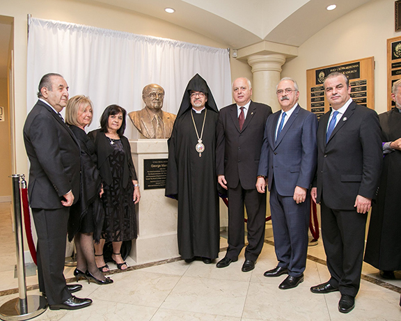 Prelate Archbishop Moushegh Mardirossian led a special unveiling ceremony of a statue honoring George Mardikian in the foyer of Bagramian Hall. From Left to Right: Haig and Argine Kelegian, who made the statue possible through their initiation and efforts; Goharik Gabriel, Chairperson of the Committee to Honor the Legacy of George Mardikian; Western Prelacy Prelate Archbishop Moushegh Mardirossian; Daron Der Khachadourian, ARF Western US Central Committee chairman; Levon Kirakosian, Esq., a member of the Committee to Honor the Legacy of George Mardikian and an ARF Western US Central Committee member; and Boghos Sassounian, ARF Dro Gomideh chairman.