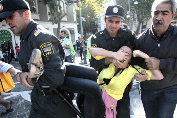 Azerbaijani police detain an opposition activist during a protest rally in Baku, Azerbaijan on Oct. 20, 2012. (Associated Press Photo)