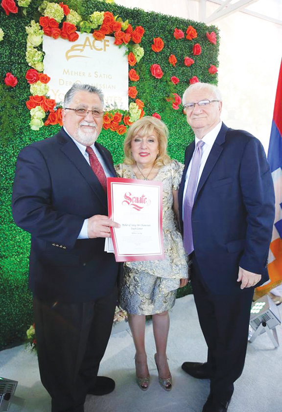 California State Senator Anthony Portantino presents a proclamation to Meher and Satig Der Ohanessian