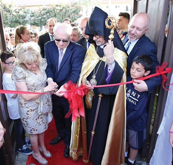 Meher and Satig Der Ohanessian cut the ribbon to the now eponymous center with Prelate Arch. Moushegh Mardirossian and ARF Zavarian Gomideh chairman Mike Kelechian