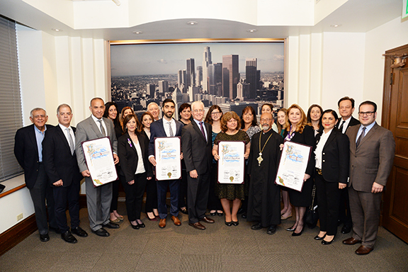 The honorees and community members with Councilmember Paul Krekprian (center) during Wednesday commemoration