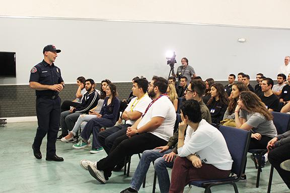 Firefighter Paramedic Ara Zakarian speaks to potential recruits