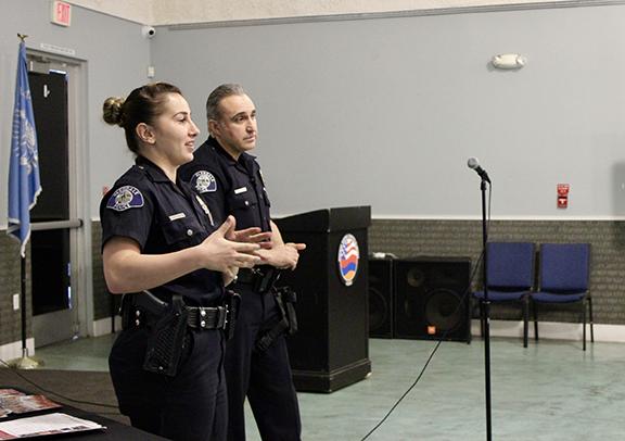 Officer Christine Kepenekian and Officer Tino Saloomen make a presentiation