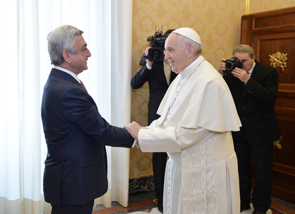 Pope Francis greets President Serzh Sarkisian on Thursday at the Vatican