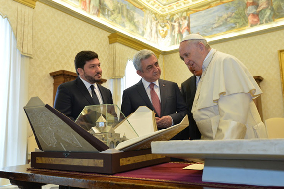 Pope Francis presents a marble copy of the sculpture of the Holy Family kept in the Vatican Museum to President Sarkisian