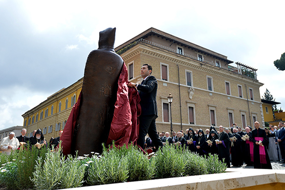 Armenia's Ambassador to the Vatican Mikael Minasyan unveils the stature of St, Gregory of Narek in the Vatican Gardens