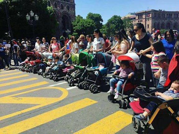 Mothers with strollers block the streets in Yerevan heeding a call for a one-day strike