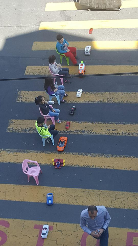 PHOTO OF THE DAY: Children take part in the People's Movement blocking the road with their toy cars. The photo has been circulating on social media