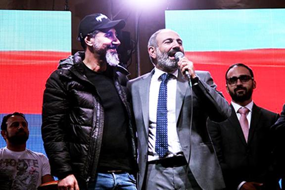 Serj Tankian joins popular movement leader Nikol Pashinyan on stage on Monday during a rally