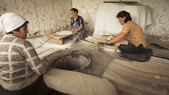 Women prepare to bake lavash (flatbread, a national staple) in Areni village, Armenia. Visitors to the Folklife Festival can expect to taste lavash and other Armenian specialties. (Photo by Sossi Madzounian, Smithsonian Institution)
