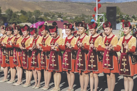 Armenian dancers wearing traditional attire. (Source: The Smithsonian)