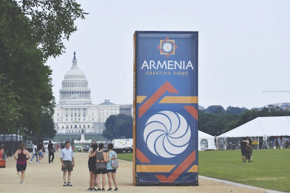 The Armenia: Creating Home board standing before the United States Capitol.