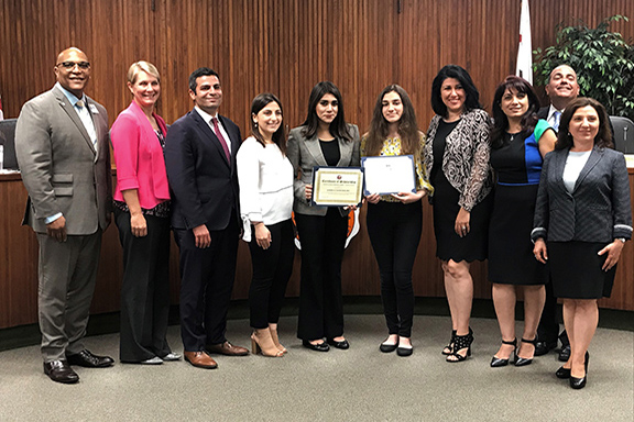 ANCA Glendale was joined by GUSD members to award scholarships to two recipients (center)