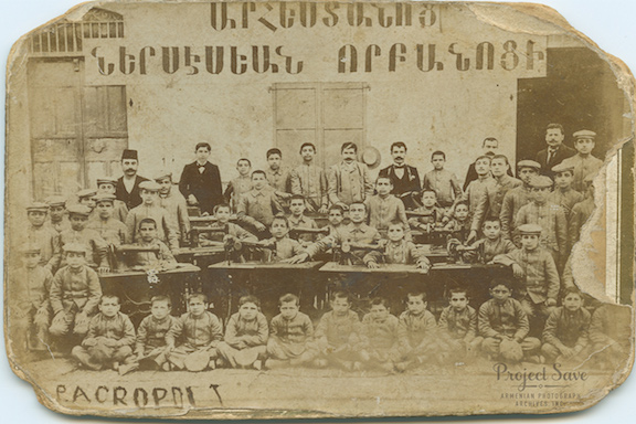 Students and teachers of the Nersessian Orphanage Trade School learn tailoring in 1902. (Source: Smithsonian)