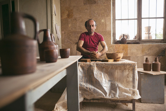 Potter Vahagn Hambardzumyan in his workshop in Sisian, Armenia. He and his wife Zara will bring their Sisian Ceramics family operation to Washington, D.C., for the Festival. (Photo by Narek Harutyunyan, Smithsonian Institution)