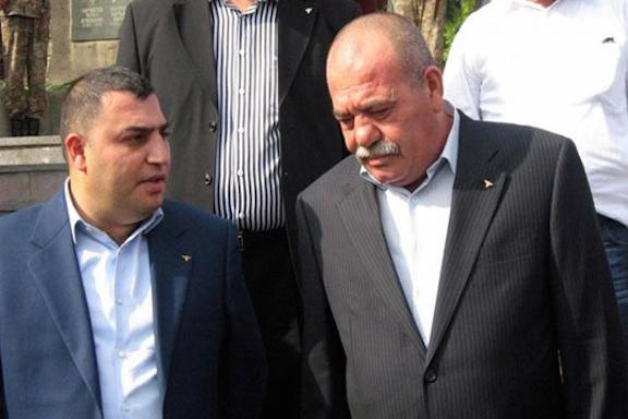 Former mayor Karen Grigoryan with his remanded father, Manvel Grigoryan.