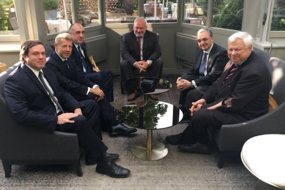The Armenian and Azerbaijani foreign ministers meeting in Brussels with the OSCE Co-Chairs present.