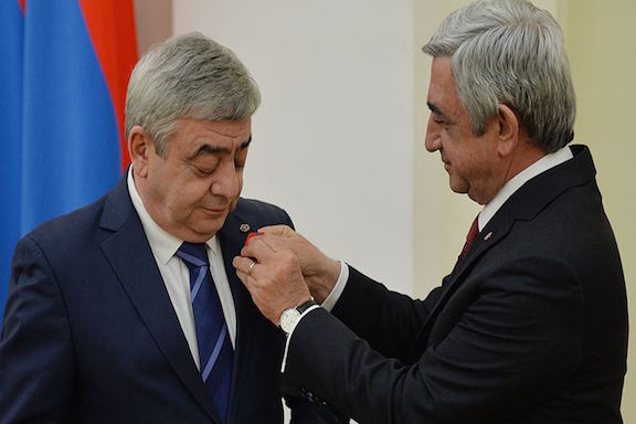 Former President Serzh Sarkisian awarding a medal to his brother, Levon Sarkisian, on March 22, 2016. (Source: Azatutyun.am)