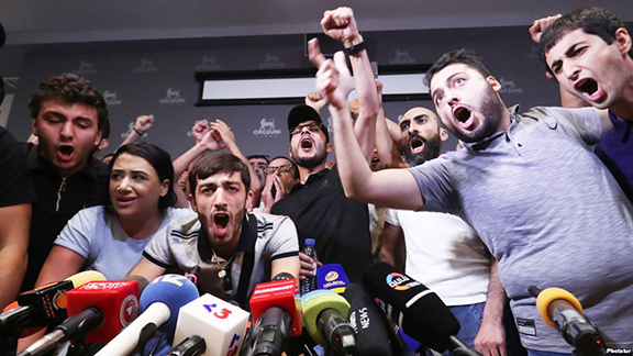 A group of protesters blocked Robert Kocharian from holding a press conference on August 14