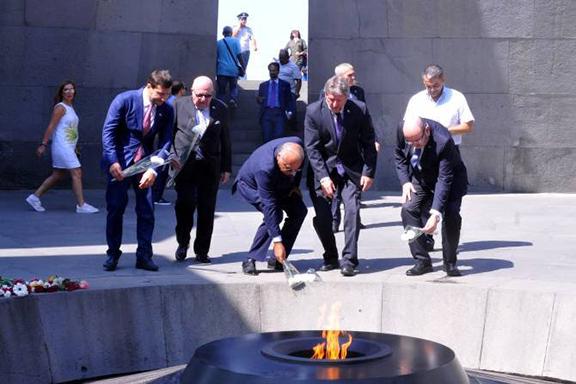 Israel's Deputy Foreign Minister Alexander Ben-Zvi places a flower at the Dzidzernagapert Genocide Memorial on Tuesday