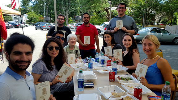 """Richmond-native Rose Soghoian offers the ANCA Leo Sarkisian interns copies of """"A Portrait of Survival,"""" penned by her sister, Florence, sharing her family's story during the Armenian Genocide."""