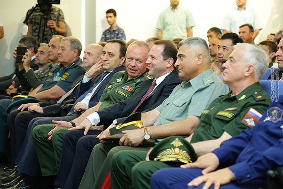 Russian Deputy Defense Minister Alexander Fomin (center left) with Armenia's Defense Minister David Tonoyan on Friday in Yerevan