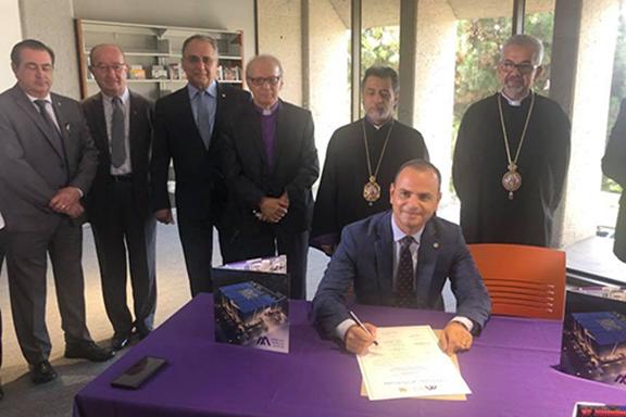 Glendale Mayor Zareh Sinanyan signs the land lease agreement as Armenian American Museum Board members look on