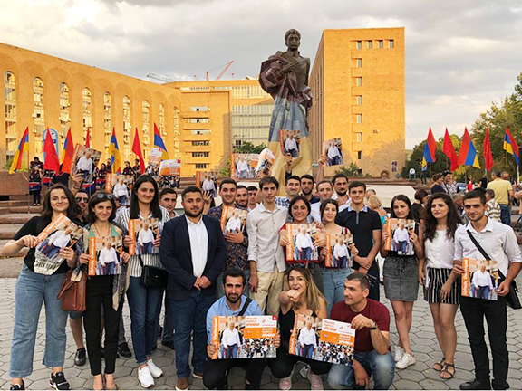 Young ARF campaigners  in front of Yerevan's new Aram Manoukian statue