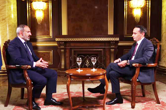 Prime Minister Nikol Pashinyan (left) during Friday's interview with Zinush