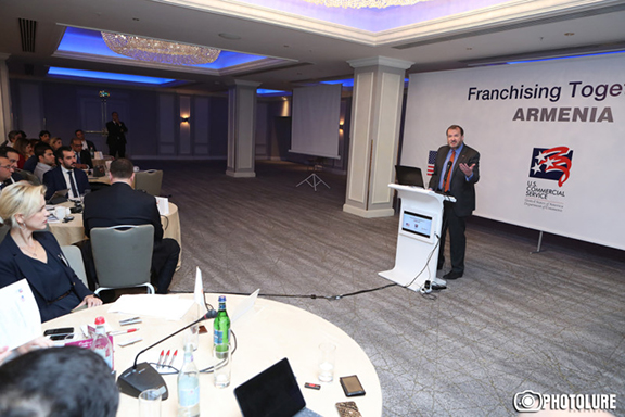 Ambassador Richard Mills makes a presentation at a franchise conference in Yerevan on Wednesday