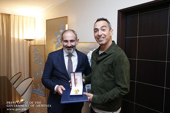 Prime Minister Nikol Pashinyan presents Medal of Gratitude to soccer star Boris Djorkaeff