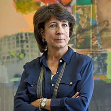 USC professor Salpi Ghazarian, Armenian Institute Director stands in front of painting done by an Armenian artist.