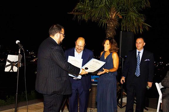 Hosts Drs. Gary Kevorkian and Sona Kazazyan receive a commendation o behalf of Los Angeles City Councilmember Paul Koretz