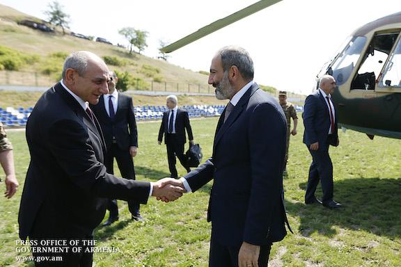 Artsakh President Bako Sahakian greets Prime Minister Nikol Pashinyan when he arrived in Artsakh in June