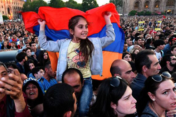THE FUTURE OF ARMENIA: A young girl during one of the protests in Armenia last spring that toppled the govenment